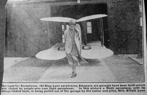 Lady Mary Heath Pulling Plane from garage